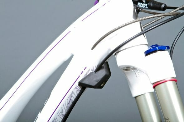 A small rubber stop under the down tube prevents the forks bumping the frame under load, or the bars twisting and scratching the top tube in a crash. And even the smallest size frame fits a full size drink bottle. Usability is important, and key to this bike's appeal.
