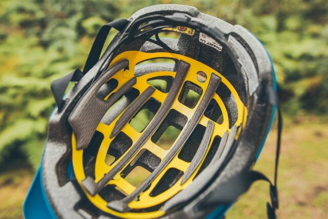 The yellow material is part of the MIPS Protection, a thin layer sitting between your head and the helmet's shell.