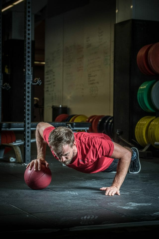 One handed ball push up