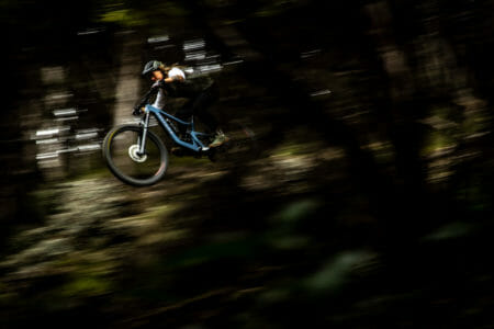 A pan shot of a new rider on the Juliana Roubion
